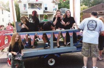 Students from St. Francis-St. Hedwig School in Naugatuck prepare for the Naugatuck Memorial Day parade on float made and donated for the day by Dan Whitman of Naugatuck. -CONTRIBUTED