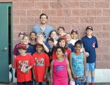Players from the Peter J. Foley Little League in Naugatuck pose for a picture with New Britain Rock Cats pitcher and Naugatuck native Pat Dean June 1. Dean pitched and earned a win that day and also signed autographs for the children. -CONTRIBUTED