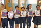 Third-graders from St. Bridget School in Cheshire, including Mischa Telesford of Prospect (last on the right), recently wrote, edited and illustrated two books through the Student Treasures program. –CONTRIBUTED