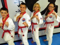 Members of USA Martial Arts in Naugatuck, from left, Nicholas Quijano, Christian Giordano, Anna DeMagistris and Kylie Ramponi were promoted to apprentice black belt at a junior grading May 22. –CONTRIBUTED