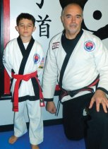 Nathan DiMatteo of Naugatuck was invited to grade to 1st Dan Black Belt at a grading to be held Aug. 22. DiMatteo, a fourth-grade student at Maple Hill School, demonstrated skills in sparring, 14 forms, Tang Soo Do Kicks, one-step self defense, rolls and break falls. DiMatteo, left, is pictured with Master Doug Wilke. –CONTRIBUTED