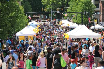 Hundreds of people fill Maple Street in Naugatuck during the Naugatuck Chamber of Commerce's annual Duck Day and Race last year. Duck Day is June 7 this year. –FILE PHOTO