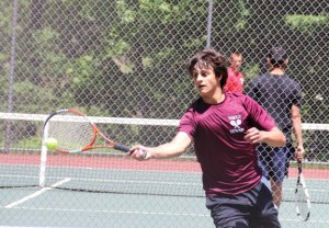 Naugatuck's Mike Popescu returns a shot during the of the NVL singles tournament last week at Wolcott High School. Popescu made it to the final match, where he lost to Alex Gauthier of Wolcott, 6-0, 6-3. –LUKE MARSHALL