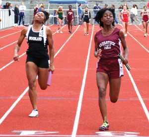 Naugatuck's Faith Okifo finishes ahead of Woodland's Ashley Michie to win the 100 meters during the NVL championship on May 28 at Naugatuck. –LUKE MARSHALL
