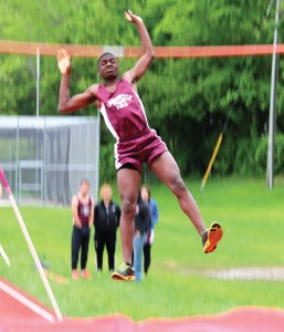 Naugatuck's Kevin Okifo clears the bar in the pole vault during the NVL championship on May 28 at Naugatuck High. –LUKE MARSHALL