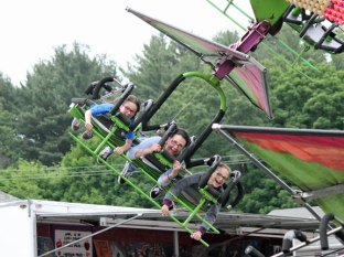 Leigh Diotalevi, center, of Seymour enjoys a ride on the Cliff Hanger with her twin daughters Mia Hlywa, left, and Annika Hlywa last year during Beacon Hose Company No. 1's annual Firemen's Carnival. This year's carnival kicks off on June 11. –FILE PHOTO