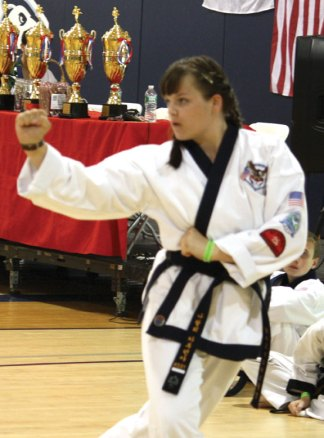 Natalie Katrenya, 13, of Beacon Falls recently made rank of Cho Dan 1st degree black belt through the TSDMA Tang Soo Do Masters Alliance. –CONTRIBUTED
