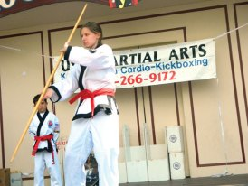 Heather McCleod demonstrates a bo staff form during Martial Arts Day at Quassy Amusement Park in Middlebury June 22. Members of USA Martial Arts of Naugatuck participated in the event. –CONTRIBUTED