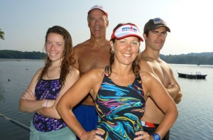 Triathlon coach Sandra Heller, foreground, has nine of her athletes competing Sunday in Ironman Lake Placid including, left to right, daughter Kristin, husband Dave and son Trevor. Another son, Brendan, completed the Challenge Atlantic Ironman on June 29. The Hellers are seen here Tuesday at the Quassapaug Sailing Center after completing an early-morning training swim. –RA ARCHIVE