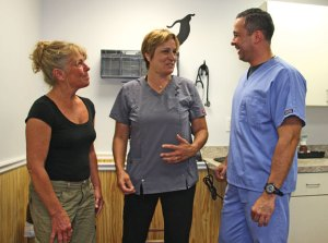 From left, Donna Rollinson, veterinarian Cheryl Sackler and Gibson Fernandez, a professor of veterinary medicine from Venezuela, talk at the Beacon Falls Veterinary Hospital July 28. The hospital is scheduled to open Aug. 5. –LUKE MARSHALL