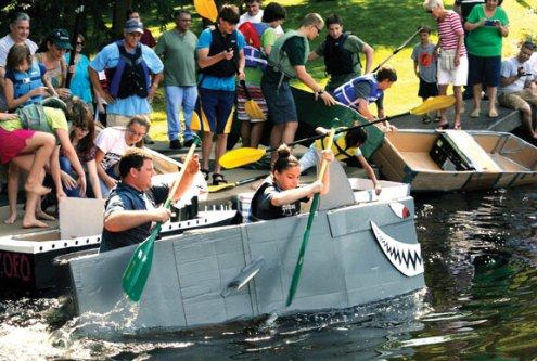 The Beacon Falls Parks and Recreation Commission hosted the Second Annual Cardboard Boat Regatta Saturday at Matthies Park. Ten cardboard crafts participated in the race with seven completing the course before sinking. Boy Scout Troop 104 of Beacon Falls took first and second place and Beacon Hose Company No. 1 took third place. Pictured, Mark Dubroski, left, and Shealyn Rodorigo set off on their cardboard boat. –CONTRIBUTED