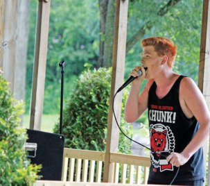 Dylan Carlson, 18, of Naugatuck sings 'Face Down' by The Red Jumpsuit Apparatus during The Sounds of Summer open mic program hosted by the Naugatuck YMCA July 10 on the Town Green. The next open mic is scheduled for Aug. 14. The program is open to teens and adults, who want to sing, play music or recite poetry. For more information, call the YMCA at (203) 729-9622. –ELIO GUGLIOTTI