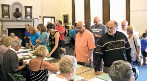 Voters fill the Naugatuck Historical Society Tuesday during a referendum on the 2014-15 budget. The municipal and school budgets were both defeated. –LUKE MARSHALL