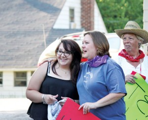 Alicia Porter, left, of Naugatuck talks with her aunt Amy Disney as Alicia's grandmother, Diane Porter, looks on June 29 during a send-off party at Hidden Acres Farm in Naugatuck. Make-A-Wish Connecticut granted Alicia's wish of meeting renowned tattoo artist Kat Von D. –ELIO GUGLIOTTI