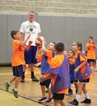 Young hoopsters play basketball July 18 at Woodland Regional High School in Beacon Falls during the half-day Hawks Hoops Basketball Clinic for children ages 5 to 8. The clinic was sponsored by the Prospect Parks and Recreation Department and ran for the entire week. A full-day basketball clinic was the week of July 7 for children ages 8 to 14. –ELIO GUGLIOTTI