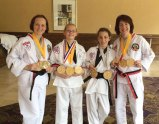 From left, Valerie Fortney, Kaitlyn Fortney, Emily Payton, and Laura Payton competed in the point sparring, combat weapons sparring, forms and weapons events at the Nashua, N.H. tournament Aug. 2. The four students of Sokol's Taekwondo in Naugatuck took home a bevy of medals. –CONTRIBUTED