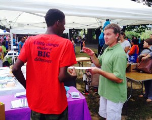 Nate Munro, right, speaks with Vincent Walker, 16, of Waterbury at the back to school rally at Library Park in Waterbury Aug. 20. Munro, a Naugatuck resident, said his heart is with people in his hometown of Ferguson, Mo. –RA ARCHIVE