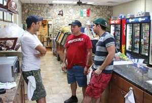 Bronx Deli owner Aldo Dasilva, center, talks with his employees Jason Machada, left, and Paulo Machada at the deli's Oxford location. Dasilva opened another location in Naugatuck in August. –LUKE MARSHALL