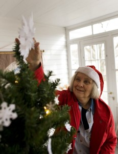 Marilyn Zera makes a final tweak to one of the Christmas trees inside The Hotchkiss House in Prospect. Zera made all of the paper snowflakes by hand. The Prospect Historical Society will be hosting tours of the 1819 building. -REPUBLICAN-AMERICAN