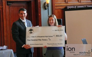 Naugatuck High School science teacher Beth Lancaster, right, accepts a grant from Naugatuck Education Foundation Chairman Matt Fortney April 23 during a reception at the Neary Ballroom. The NEF awarded eight grants totaling $30,000. –LUKE MARSHALL
