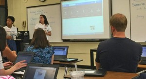 Naugatuck High School students, Veronica Rangel, front left, and Gina Wierzbicki conduct a class in which they taught dozens of teachers how to use technology to improve classroom lessons. They taught at the first Naugatuck technology summit at City Hill Middle School Tuesday. -REPUBLICAN-AMERICAN