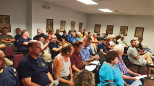 Residents and Prospect Gun Club members begin to pack into Town Hall during a public hearing on a proposal to extend the hours of the club's shooting range on Sept. 2. –LUKE MARSHALL