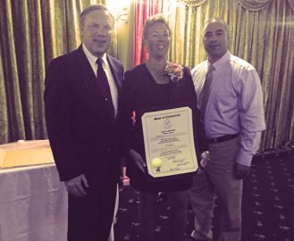 Beacon Falls police Officer Caroline O'Bar was honored by the Valley Women's Health Initiative Oct. 1 at the 15th Annual Women Making a Difference in the Valley Tribute Luncheon and Breast Cancer Fundraiser. The tribute recognizes women who have made positive contributions to the community and have demonstrated significant achievement in their fields of endeavor, both professional and volunteer. O'Bar's community work includes volunteering as a D.A.R.E program officer and coordinating annual toy and back to school drives. O'Bar is pictured with Beacon Falls First Selectman Chris Bielik, left, and Lt. Eddie Rodriguez. –CONTRIBUTED