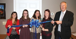 Naugatuck Youth Services held a ribbon cutting ceremony Nov. 13 to kick off its official 'grand opening.' Pictured, from left, Waterbury Chamber of Commerce Special Events Director Courtney Ligi, Naugatuck Youth Services Board of Directors Youth Representative Allison Tortorici, Naugatuck Youth Services Administrative and Program Coordinator Kathy Gallagher, Naugatuck Youth Services Director Kristin Mabrouk, and Naugatuck Mayor N. Warren 'Pete' Hess. –LUKE MARSHALL