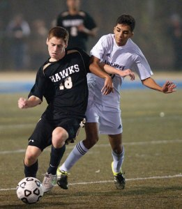 Woodland's Senol Music (18) and Naugatuck's Yan Silva (10) battle for the ball during the NVL boys soccer tournament final Nov. 5 at Municipal Stadium in Waterbury. Naugatuck won, 2-0. -REPUBLICAN-AMERICAN