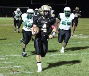 Woodland's Sean McAllen (4) returns the opening kickoff 86 yards for a touchdown versus Wilby Oct. 30 in Beacon Falls. Woodland won, 39-6. –ELIO GUGLIOTTI