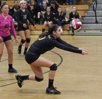 Woodland's Carla Piccolo bumps the ball during the Class M quarterfinals versus Rockville Friday in Beacon Falls, Woodland won, 3-0. –ELIO GUGLIOTTI