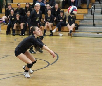 Woodland's Gina Farina bumps the ball during the Class M quarterfinals versus Rockville Friday in Beacon Falls, Woodland won, 3-0. –ELIO GUGLIOTTI