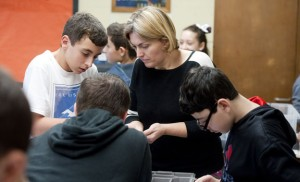 Allison Stephens, a teacher at City Hill Middle School in Naugatuck, works with students, from left, Kyle DeRosa, Connor Testone and Alex Rivera, during an Exploring Engineering project class on robotics Friday at the school. –REPUBLICAN-AMERICAN