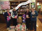 The Naugatuck Emblem Club recently donated over 200 books, $200 worth of hats and mittens, and three complete Thanksgiving day meals to Salem School to help families in need. The club has adopted Salem School this year for its community service projects. Pictured, from left, Angie Flamer, Annette Balog, Salem School Principal Jennifer Kruge and Wendy Meagher. –CONTRIBUTED