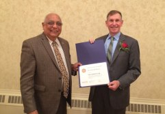 Rotary Past District Governor Rupi Rupwani, left, presents Kevin McSherry of Naugatuck with the Paul Harris Award Nov. 17 at the Crystal Room. McSherry was honored by the Naugatuck Rotary Club for his many years of service to the Naugatuck community. –CONTRIBUTED
