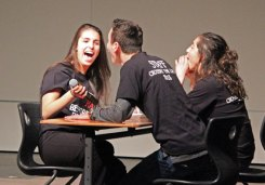 Naugatuck High students, from left, Alexandra Silva, Michael Huzior and Alanna Readel portray bullies during a skit Dec. 10 during the anti-bullying assembly 'Crossing the Line' at the school. The assembly is organized by the school's DECA chapter and presented to the entire sophomore class. The program featured information on the consequences of bullying and what students can do to deal with bullying. –ELIO GUGLIOTTI