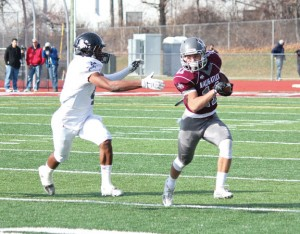 Naugatuck's Jalen Datil (11) looks to shake off Ansonia's Tajik Bagley (4) Thanksgiving morning in Naugatuck. Ansonia won, 41-8. –ELIO GUGLIOTTI