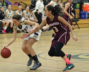 Naugatuck's Alyana Sosa (3) pressures Woodland's Eliza Smith (11) as she brings the ball up the court Dec. 18 in Beacon Falls. Woodland won the game, 41-27. –ELIO GUGLIOTTI