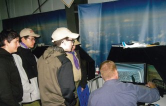 Naugatuck Boy Scout Troop 109 visited the New England Air Museum in Windsor Locks Dec. 4. The scouts got to use a flight simulator during the tour of the museum. –CONTRIBUTED