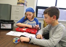 Sixth-grader Mary Grant works on finding the correct Lego piece for a robot while her teammate, fifth-grader Matt Huk, looks over the instructions Jan. 14 at Beacon Falls Town Hall as part of the Beacon Falls Library's Lego Robotics program. –LUKE MARSHALL