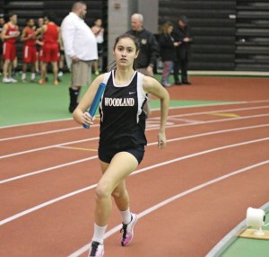 Woodland's Erin Machado runs in the 4x800 during the NVL indoor track championship Monday at the Floyd Little Athletic Center in New Haven. –LUKE MARSHALL