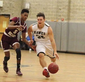 Woodland's Adem Rifati (30) pushes the ball up the court as Sacred Heart's Courie Stevenson (5) defends Monday in Beacon Falls. Sacred Heart won the game, 99-49. –ELIO GUGLIOTTI