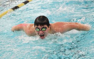 Woodland's Jordan Baer competes in the 100 butterfly versus Naugatuck Jan. 20 in Beacon Falls. Naugatuck won the meet, 92-83. –ELIO GUGLIOTTI