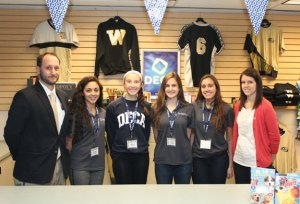 Woodland Regional High School DECA advisers and officers, from left, Chris Tomlin, Treasurer Alexa Casimiro, Secretary Eliza Smith, Vice President Val Vinca, President Sonia Sousa, and Jenna Broadbent stand in the school store last week. The DECA chapter, which started at the school in December 2014, has been focusing on growing and reviving the store. –ELIO GUGLIOTTI