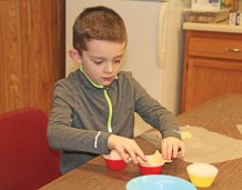 Brayden Blake, 5, left, and Jayden Wood, 8, both of Naugatuck, make meatball muffins during a cooking class run by the Naugatuck Parks and Recreation Department Jan. 21. –LUKE MARSHALL