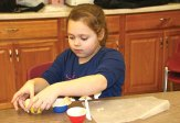 Sophia Deown, 8, of Naugatuck makes a meatball muffin a cooking class run by the Naugatuck Parks and Recreation Department Jan. 21. –LUKE MARSHALL