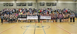 The Woodland and Torrington boys basketball teams, Woodland's cheerleaders and dance team, officials and fans pose at midcourt Feb. 19 in Beacon Falls for a photo to support 8-year-old terminal cancer patient Dorian Murray. –ELIO GUGLIOTTI