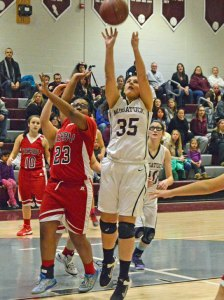 Naugatuck's Ally Mezzo (35) battles for a rebound Jan. 29 versus Derby in Naugatuck. Naugatuck won the game, 40-35. –KEN MORSE
