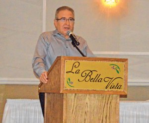 Retired Naugatuck High School boys soccer head coach Art Nunes addresses the audience during a retirement dinner in his honor Feb. 6 at the Pontelandolfo Club in Waterbury. Nunes retired after the fall season, which was his 21st leading the team. –KEN MORSE