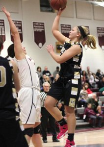 Woodland's Cameron Caswell puts up a shot over the outstretched arms of Naugatuck's Ally Mezzo Feb. 12 in Naugatuck. Woodland won the game, 40-31. –ELIO GUGLIOTTI